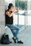 Student travels with the mirrorless digital camera. Royalty Free Stock Photos