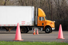 Student truck driver practices parking maneuvers. Student truck driver trains in parking maneuvers Royalty Free Stock Photography