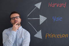 Student is trying to choose the right college. For his future stock images