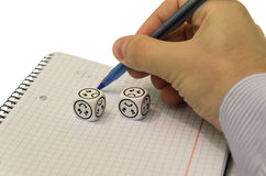 Student trying to solve mathematical equation without success. Sad dices - stock photo royalty free stock photography