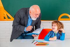 Student and tutoring education concept. Thank You Teacher. Grandfather talking to son. Family generation and relations