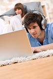 Student - Two teenager with laptop and headphones. Woman reading book relaxing Stock Images