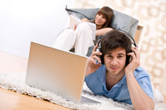 Student - Two teenager with laptop and headphones Royalty Free Stock Image