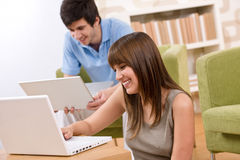 Student - two teenager with laptop in living room Stock Photo
