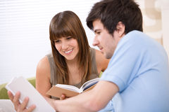 Student - two teenager reading book home Stock Photography