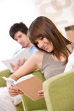 Student - two teenager reading book home Stock Image