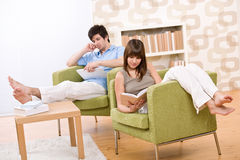Student - two teenager reading book in lounge Stock Photography