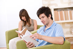 Student - two teenager reading book in lounge Royalty Free Stock Photography