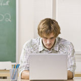 Student typing on laptop Royalty Free Stock Image