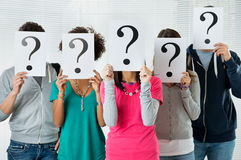 Student uncertainty. Students Hiding There Face With Question Mark Sign, uncertainty of their future concept Stock Photos