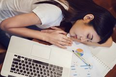 Student in university sleeping after finish home worke on the de. Sk with computer notebook, This immage can use for over work, education, job, business, work Stock Photo