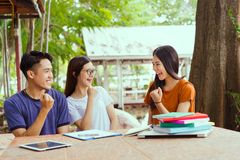 Student university success project concept. Students asian working complete and finish job happy feeling with friends smiling at campus high school college stock images