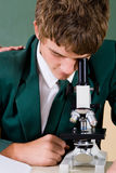 Student use microscope Royalty Free Stock Photos