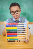 Student using an abacus in class Royalty Free Stock Image