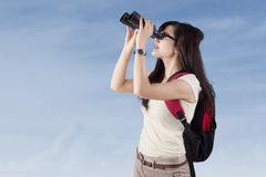 Student using binoculars outdoors Royalty Free Stock Images
