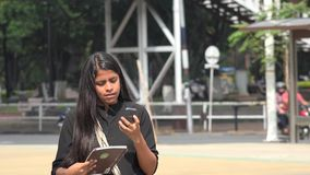 Student Using Cell Phone stock video footage