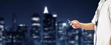 Student Using Cellphone with Building Skyline Background. Student in school uniform with ID checking and using cellphone. Blurred skyline building background Stock Photos