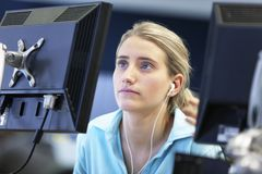 Student Using Computer And Listening Music Stock Photos