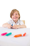 Student using crayons to draw Stock Image