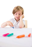 Student using crayons to draw Royalty Free Stock Images