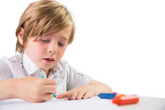 Student using crayons to draw Royalty Free Stock Photos
