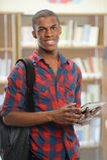 Student Using Electronic Pad Stock Photo