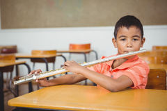 Student using a flute in class Stock Photos