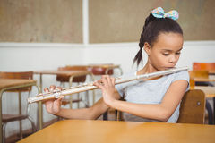 Student using a flute in class Royalty Free Stock Image