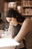 Student using futuristic hologram to learn biology from tablet Stock Photo