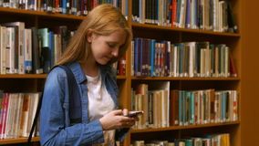 Student using her smart phone. In the university college stock video