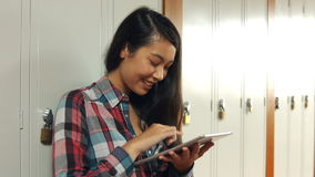 Student using her tablet pc stock footage