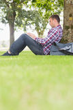 Student using his laptop to study outside. On college campus Royalty Free Stock Photography