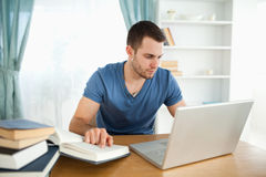 Student using his notebook to work Royalty Free Stock Images