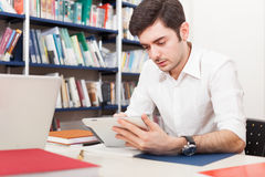 Student using his tablet Stock Photos