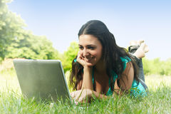 Student using laptop. Happy student using laptop outdoors Stock Photography