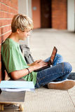 Student using laptop. Male high school student using laptop in school Royalty Free Stock Image