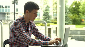 Student using laptop in cafe. In high quality 4k format stock video footage