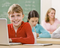 Student using laptop in classroom Royalty Free Stock Photos