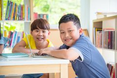 Student using laptop computer in library. Young asian student using laptop computer in school library Royalty Free Stock Photography