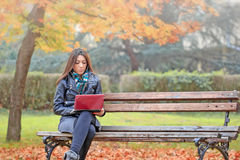 Student using laptop to learning outdoors Stock Photo