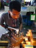 Student using lathe machine Stock Images