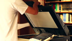 Student using the photocopier in the library stock footage