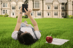 A student using smarpthone outdoor Royalty Free Stock Images