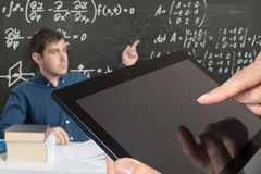 Student is using tablet in classroom in school. Education and technology concept.  Stock Images