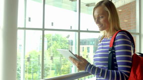 Student using tablet in college stock video footage