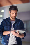 Student using tablet computer Stock Photo