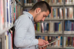 Student Using A Tablet Computer In A Library Stock Photos