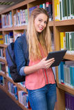 Student using tablet in library Stock Photo