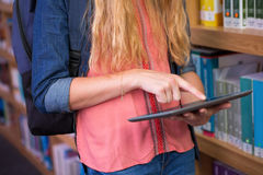 Student using tablet in library Stock Images