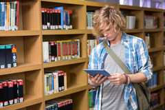 Student using tablet in library Stock Image